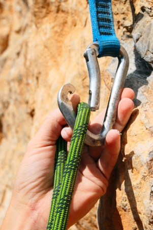 Rope for climbing and quick-draws photo