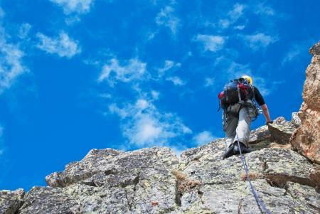 Extreem sport  Climber on the mountain summit