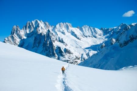Extreme Sport  Lone hikers in winter mountains