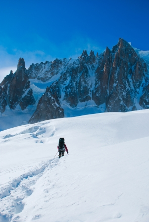 Extreme Sport  Lone hikers in winter mountains photo