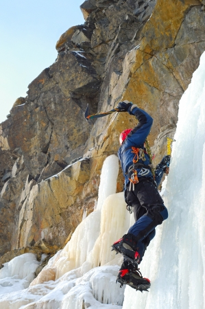 ice axe: Professional climber on icy waterfall
