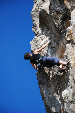 The rock-climber during rock conquest photo