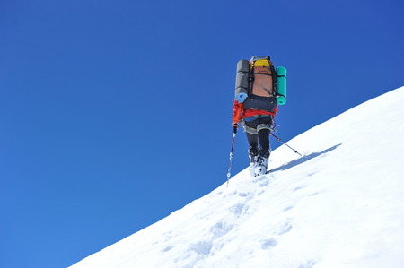 Climber on snowy summit