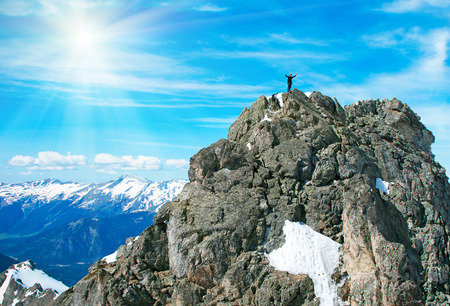 Climber on the rock mountains photo