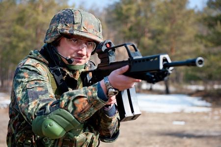 assault rifle: Young soldier on patrol