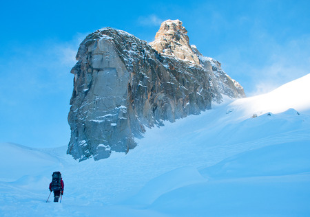 Extreme Sport. Lone hikers in winter mountains photo