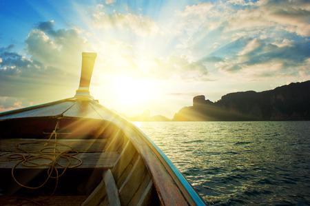 boundless: boat  under sunset light