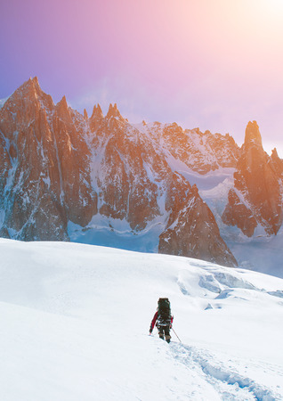 distant: Extreme Sport. Lone hikers in winter mountains