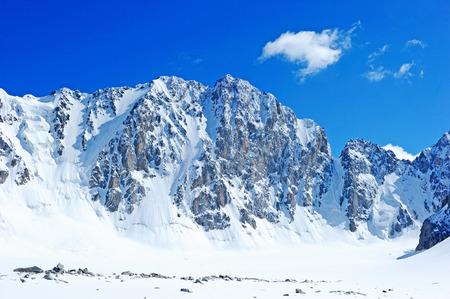 Blue sky over snowy white mountains photo