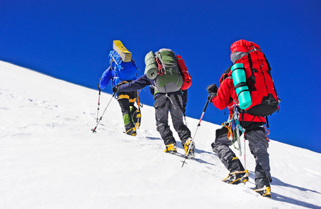 expedition: Two mountain backpackers walking on snow