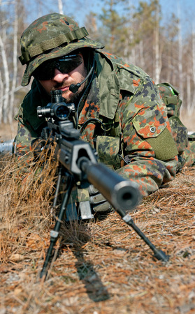 rifleman: Masked sniper is aiming at the target during the mission