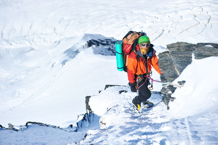 altitude: Climber on the snowy mountains