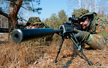sniper: shooting camouflage sniper Stock Photo