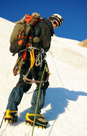balances: Alpine climber balances on the ice snowfield