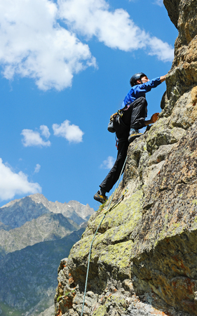 extreme sports: The rock-climber during rock conquest