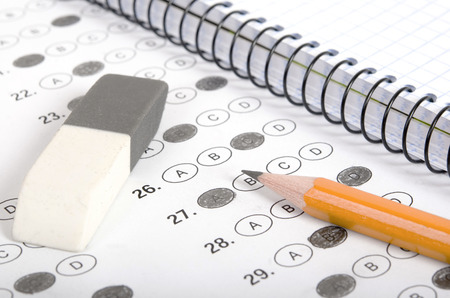 multiple choice: School and Education. Test with pencil, notebook and eraser
