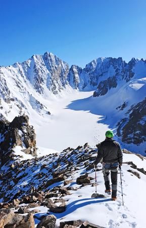 Mountaineer climb to the high mountain peak photo