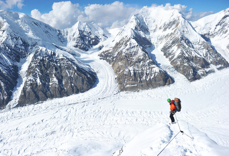 the snowy mountains: Climber on the snowy mountains