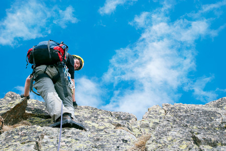 Risk Free: Lone male mountain climber  on the summit