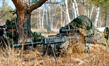 sniper rifle: camouflage sniper Stock Photo