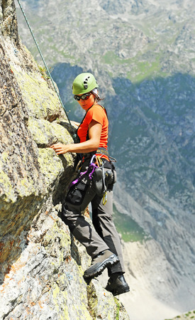 belay: The rock-climber during rock conquest