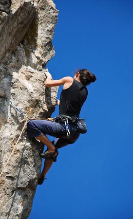 conquest: Extreme sport. The rock-climber during rock conquest