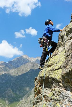 steiermark: Young man climbs on a rocky wall