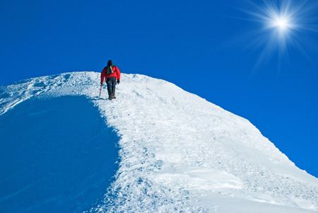 ice climbing: Lone male mountain climber  on the summit