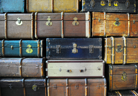 Vintage weathered leather suitcases on top of each other photo