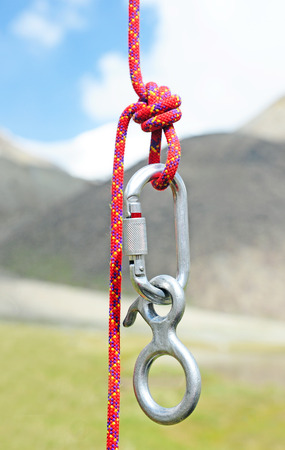 rappelling: Climbing equipment - carabiner and rope