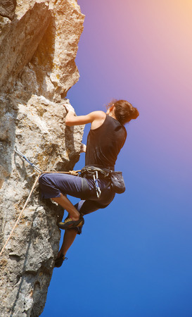 rockclimber: Extreme sport. The rock-climber during rock conquest