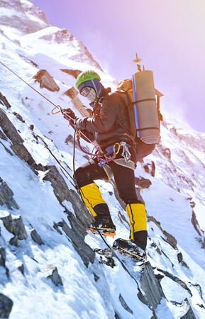 extreme sports: Climber going to the summit