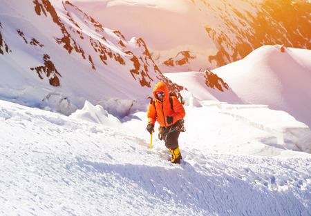 high spirits: A lonely climber reaching the summit Stock Photo