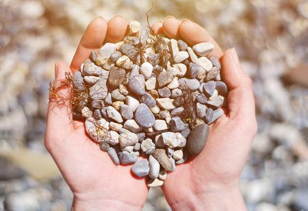 calm water: Stones in Hands Stock Photo