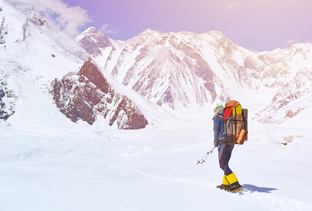 summits: A lonely climber reaching the summit Stock Photo