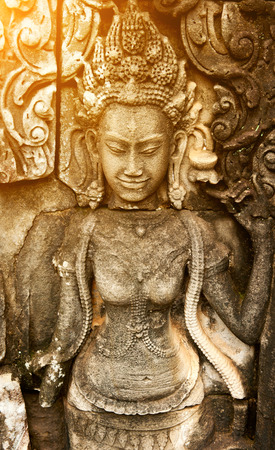 stone buddha: Statue of woman on the wall in ancient temple in Thailand