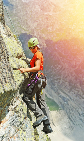 summits: A climber reaching the summit Stock Photo