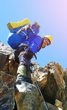 mount: A climber reaching the summit Stock Photo