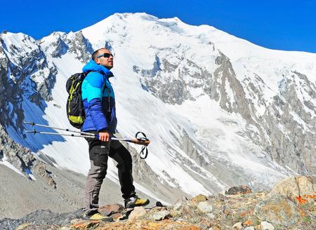 Hiker on the trek in Himalayas Stock Photo
