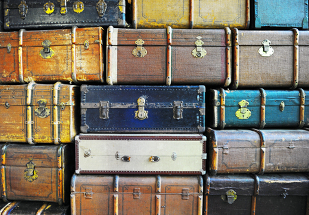 old suitcase: Vintage weathered leather suitcases on top of each other