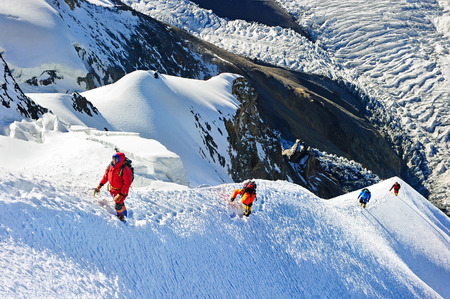 mount: Group of  climbers reaching the summit