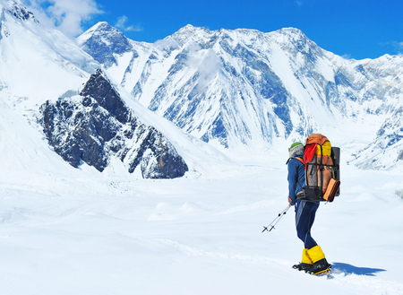 himalaya: A lonely climber reaching the summit Stock Photo