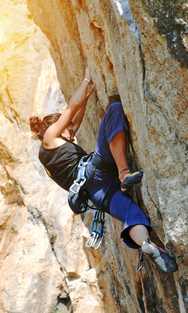 mount: Extreme sport. The rock-climber during rock conquest