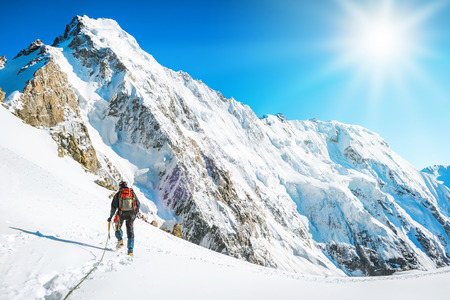 top mountain: Tourist with a backpack and mountain panorama. Extreme sport concept
