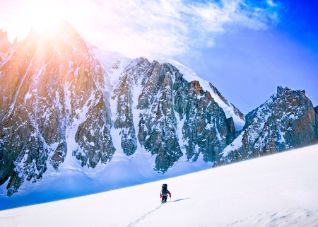 endeavor: Hikers in winter mountains. Extreme sport concept