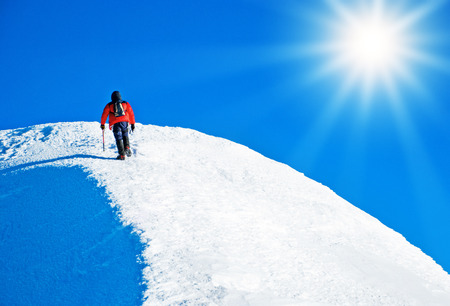 everest: A climber reaching the summit. Extreme sport concept