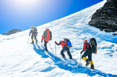 hikers: Group of climbers reaching the summit. Extreme sport