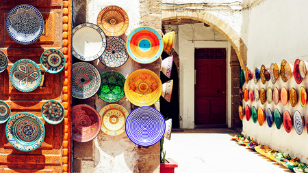 antique shop: Traditional arabic handcrafted, colorful decorated plates shot at the market in Marrakesh, Morocco, Africa. Stock Photo