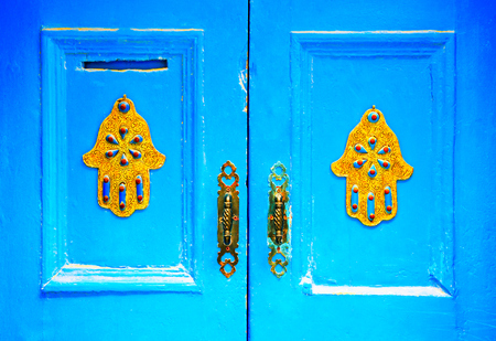 door handles: The doors made of wood painted blue. Decoration concept