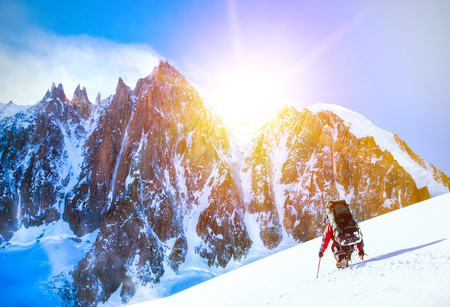 elbrus: A climber reaching the summit of the mountain.